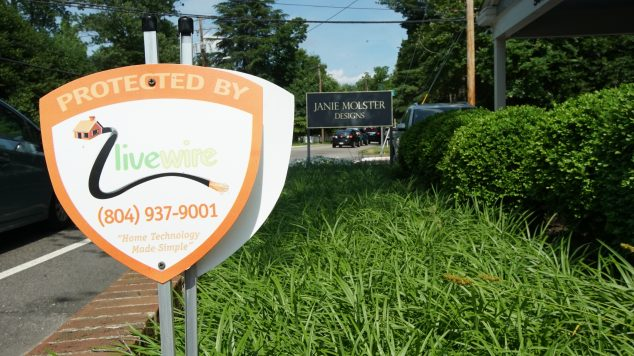 Livewire sign displayed on the front lawn of a local business